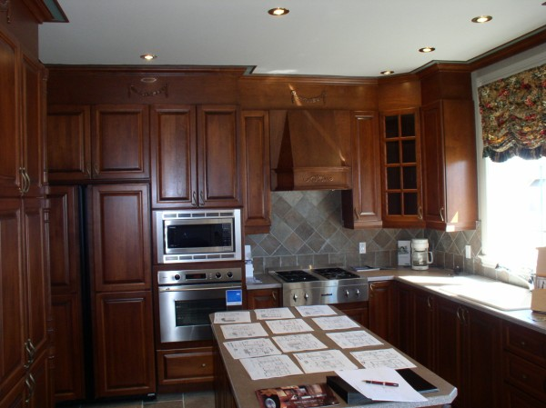 Varnished kitchen in massive cherry wood